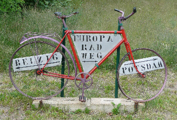Old bike transformed into a cycle-path sign