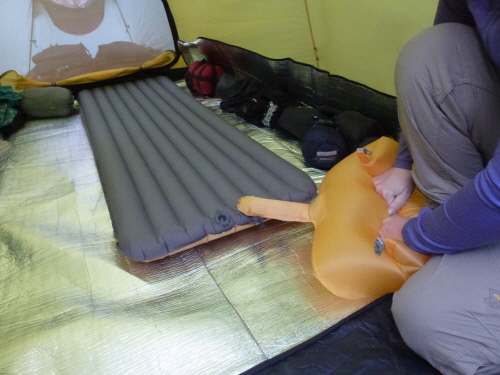 ....then continue rolling and compress to inflate the mat.