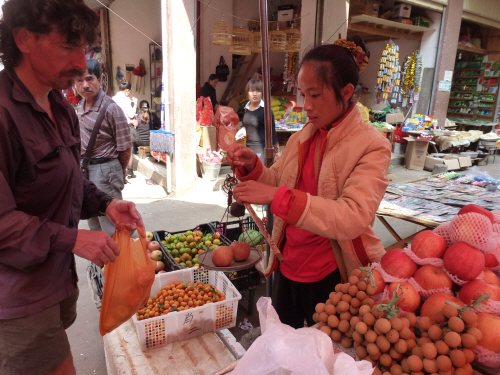 We love the hand-held scales they use to weigh produce at the market. Oh, and see the man looking over on the right of Keith? I took several shots to catch the stall holder in the act of weighing and  whilst there's a changing stream of people walking by this guy is in ever shot, just staring at the apparently extraordinary sight of someone buying some apples!