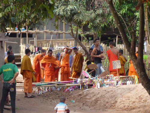 The Buddhist nature of the Tai Lue people became apparent in their celebrations when the monks paraded through the village.