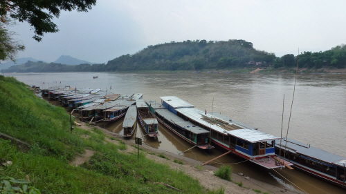 The mighty Mekong flowing around the town.