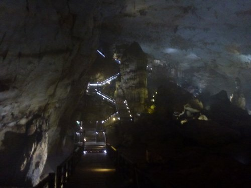 The gigantic stalagmite near Paradise Cave entrance (viewed from below with the stairs winding up around it)