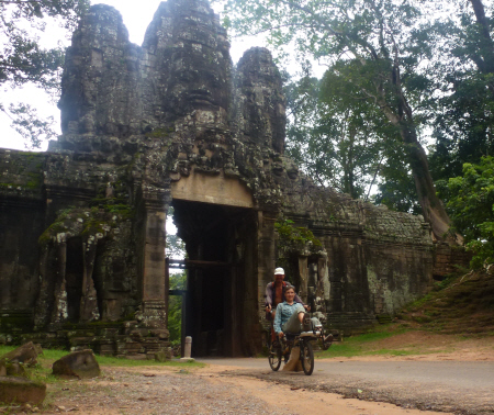 Cycling through the East Gate of Angkor Thom on our way to Bayon.