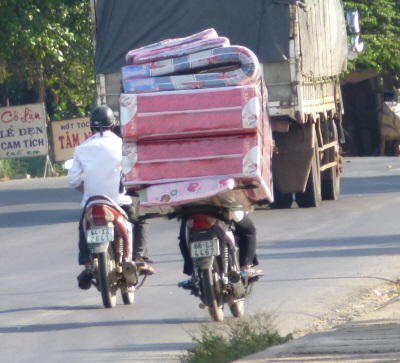A strong contender in this year's How Many Mattresses Can You Fit On A Motorbike contest.