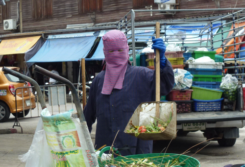 Superficially Thailand can sometimes feel more Muslim than Buddhist, but this head covering is actually for sun protection rather than religious reasons.