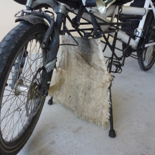 Cut nylon sack is a light-weight & effective mud-flap