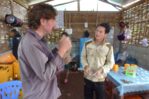 Keith being taught some Lao words by an English teacher who was moonlighting in his wife's cafe during the school holidays.