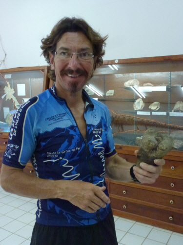 Keith clutching a fossilized T. Rex elbow.
