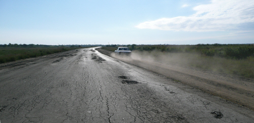 With cars preferring the hardpacked dirt at the side of the road we had Ukraine's tarmac all to ourselves.