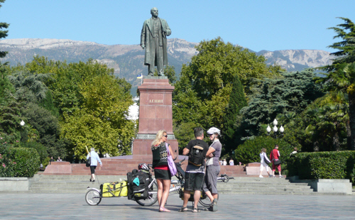 Keith wanted a photo of the bike and me alone in front of Lenin....but people kept coming to talk to us.  :-)