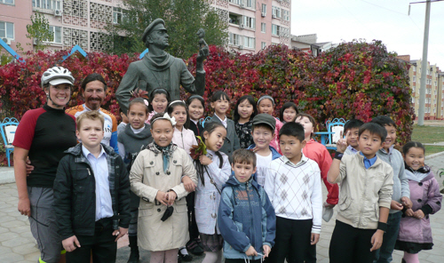 Elista school children at the statue of fictional chess master Ostap Bender.