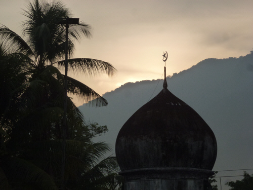 Mosque at dawn.  As we travel south Islam overtakes Buddhism as the predominant religion.