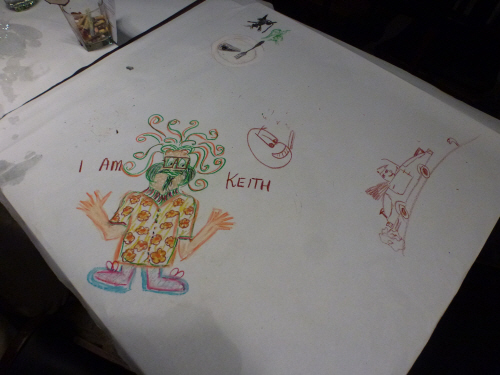Noey, Keith and Tamar's artistic contributions to the tablecloth at the cake shop in Georgetown where diners are provided with crayons and given free rein (Noey's picture of Keith was by far the best in our opinion).