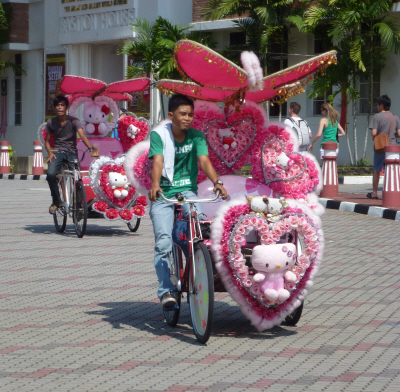 Georgetown's trishaws are prettily decked out with plastic flowers, but in Melaka they take trishaw decoration to a whole new level.