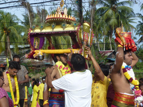 Other family members preceded the devotee on the pilgrimage carrying smaller burdens