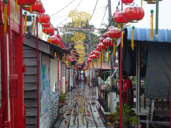 Another decorated clan jetty after a shower of rain. Note the golden ram decoration – each golden figure represents a different animal of the Chinese lunar cycle.