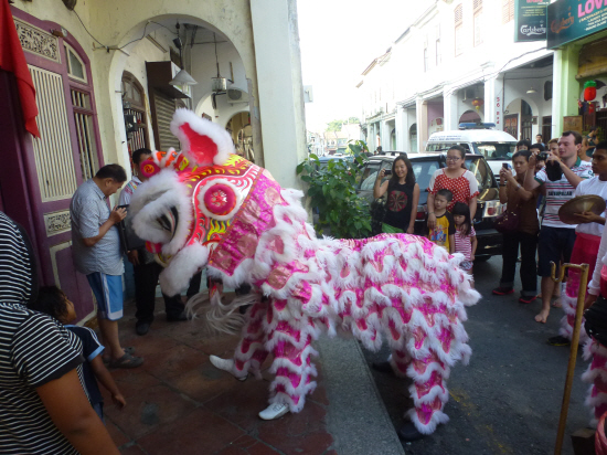Lion Dance going into a guesthouse – the ears can flap and the eyelids can wink closed!