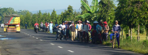Workers on their way to the fields.