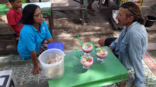 "Keith trying out his ""Bahasa Indonesia"" before we tuck into some delicious Es Teler – a cooling concoction of shaved ice, avocado, melon, jackfruit, coconut, tapioca, rose syrup, condensed milk and jellies...mmm-mmm!"