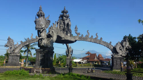 The Pino, dwarfed by an ornate Balinese archway].